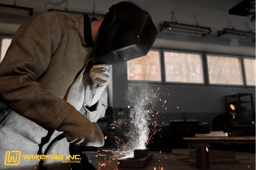 Working doing work in manufacturing with welding equipment